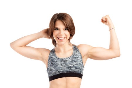 woman muscle: Smiling fit young and attractive woman in studio