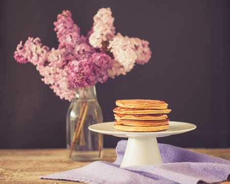 Healthy american whole grain spelt pancakes on white plate
