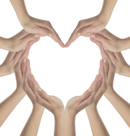 Female hands making a heart shape isolated on white