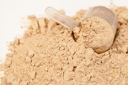 whey: Chocolate flavoured protein whey powder with scoop Stock Photo