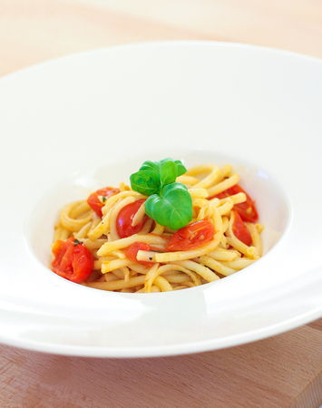traditional italian pasta with basil and tomato