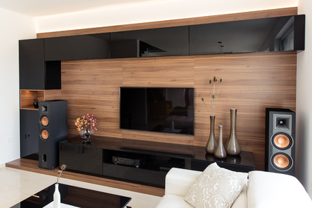cabinets: Elegant living room with black and oak cabinets