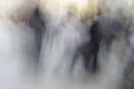 blurred people: Heavily blurred people on the street Stock Photo