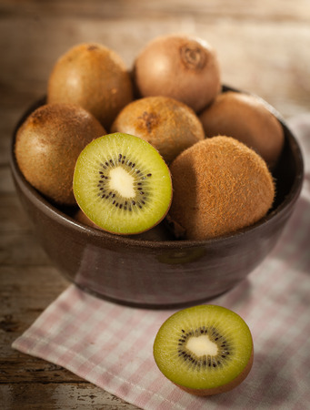 rustical: Kiwi fruit in a bowl on rustical wooden table
