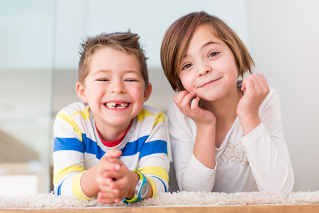 Cute little siblings making funny faces