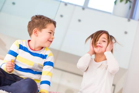 siblings: Cute little siblings making funny faces
