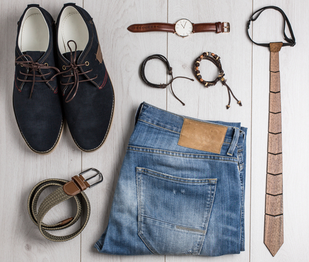suede belt: Casual male accessories overhead on white wooden board