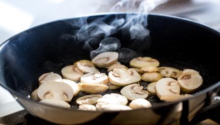 roasting pan: Roasting sliced organic  champignon mushrooms in pan