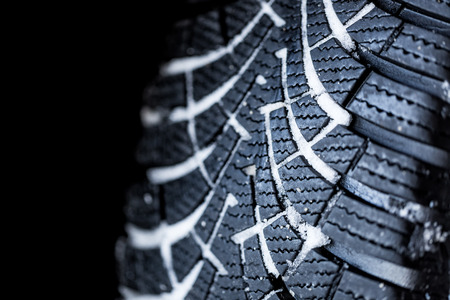 grooves: Winter tire with snow in the tire grooves