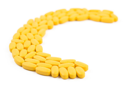 vitamin pill: Pill supplement of Vitamin C shaped in letter Stock Photo