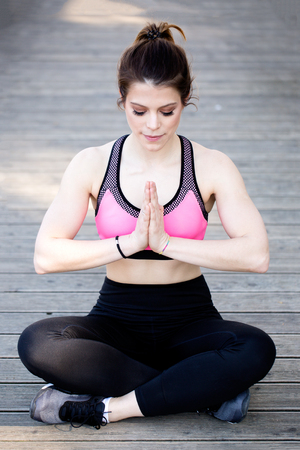 Beautiful young fit brunette woman doing yoga