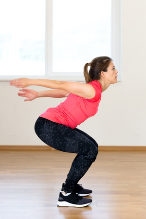 Active young woman exercising at the gym Stock Photo - 88029792
