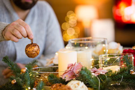 Bearded man decorating christmas table with bubbles Stock Photo