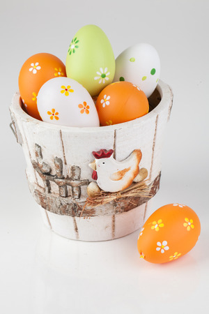 Pot and easter eggs decoration on white table