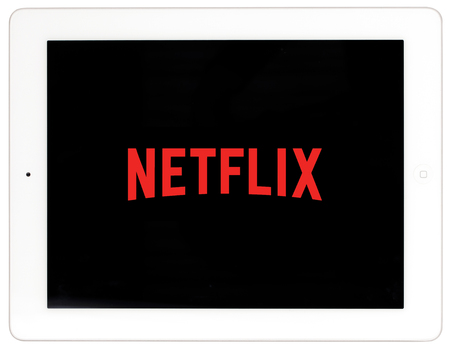 Ljubljana, Slovenia - February 3rd 2019: NETFLIX logo on white iPad. Netflix is an american global on-demand internet streaming media provider
