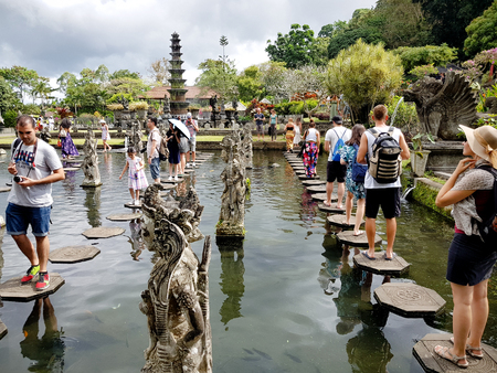 Many tourist at hight season in Tirta Ganga