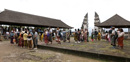 Lempuyang, Bali / Indonesia - August 16th 2018: Overcrowded balinese Lempuyang temple gates. Tourists are waiting in line for 2 hours to take a photo. Editorial