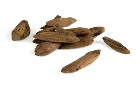 Small pieces of oud fragrance wood isolated on white