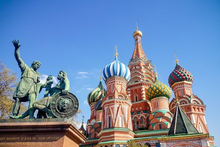 Monument to Minin and Pozharsky and Saint Basil's Cathedral on the background, on the Red Square in Moscow Russia
