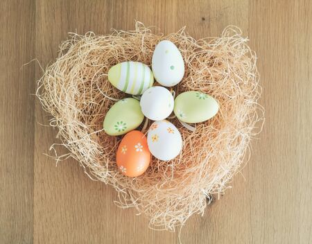 Heart shaped nest with easter eggs, top view