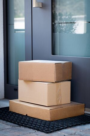 Packages left at front door for contactless delivery of online bought items