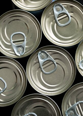 Stockpiling cans of different kind of food due to coronavirus outbreak and stay at home concept Foto de archivo