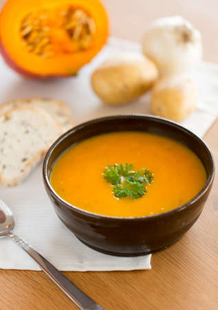 Homemade pumpkin soup with parsley Stock Photo
