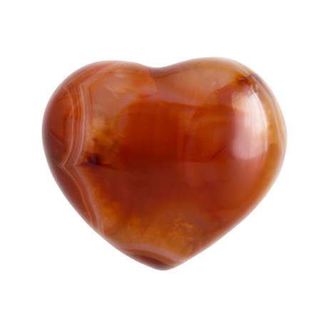 Semiprecious spiritual carnelian heart shaped stone isolated on white