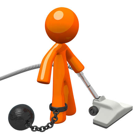 Man with a ball and chain, vacuuming. Definitely hard labor! Suggests the boring captive feeling of domestic chores. Stock Photo - 15805910