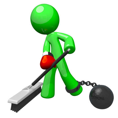 immaculate: Green man with a boxing glove and ball and chain, sweeping the floor. A good concept for substandard working conditions and employee dissatisfaction. Stock Photo