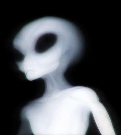 Grey alien illuminated as he passes through dimensions Reklamní fotografie