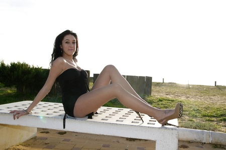young brunette woman outdoors posing for the camera alone Stock Photo - 16405112