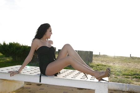young brunette woman outdoors posing for the camera alone Stock Photo - 16405113