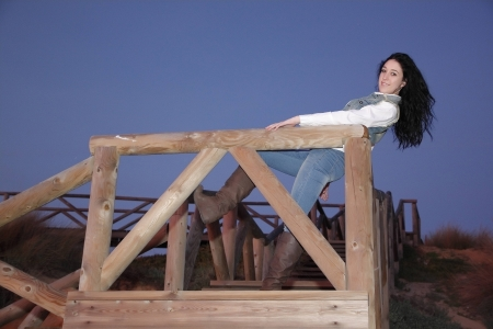 young brunette woman outdoors posing for the camera alone Stock Photo