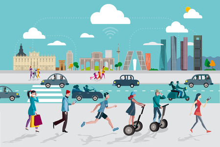 gens courir: Madrid Skyline avec quelques-uns des b�timents les plus importants et les plus repr�sentatifs de cette ville. Les gens marchant dans la rue en utilisant leurs t�l�phones intelligents.