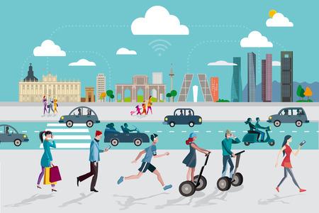 turista: Madrid Skyline con alcuni degli edifici più importanti e rappresentativi di questa città. Persone che camminano per la strada utilizzando i loro telefoni intelligenti.