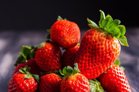 Strawberries on dark wooden background Banco de Imagens