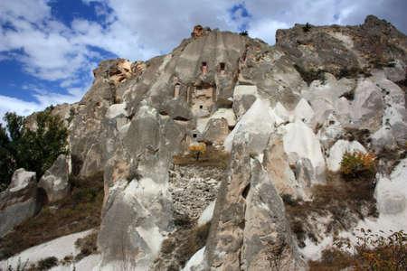 Cliff dwelling in tuff stone formation in Cappadocia, Turkey