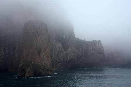 Neptunes Bellows is a strait and the entrance to Deception Island. The island is the summit area of an active volcano.