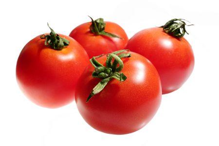 tomatoes isolated on white photo