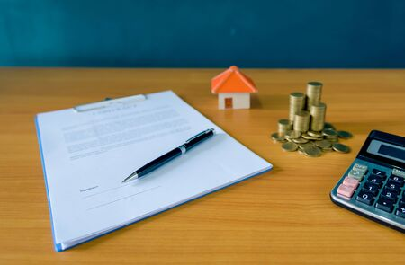 Mortgage contract for sale of real estate property with a pen an– stock image