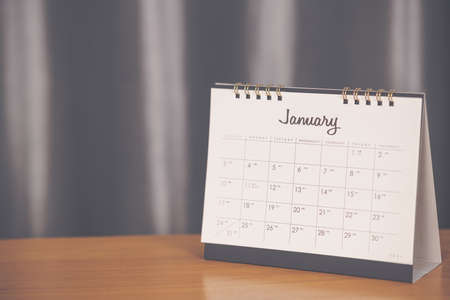 Month January in 2021 paper calendar on the wooden table