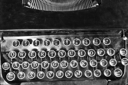 Antique Typewriter - An Antique Typewriter Showing Traditional QWERTY Keys V photo
