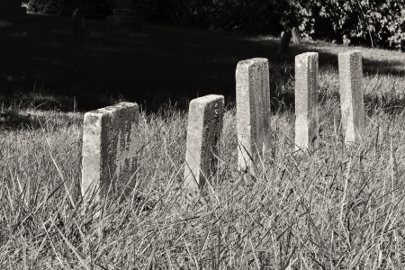unmarked: A Row of Unmarked Small Child Headstones Horizontal - A Row of Unmarked Small Child Headstones in Black and White