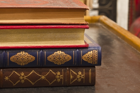 inlay: Antique Books - Antique Books with Gold Inlay Stacked on a Table