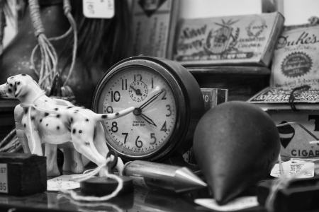 old items: Antiques for Sale - Black and white of antiques on a shelf for sale at a local antique shop