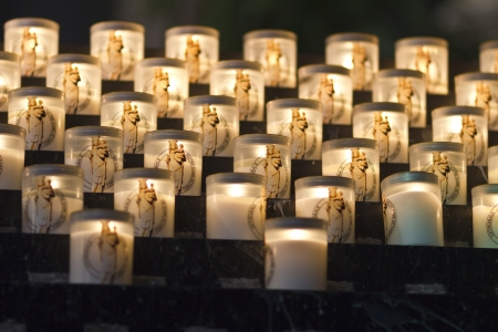 votive candle: Lit Candles in Notre Dame - Lit Candles in Notre Dame du Paris For Prayer or Memorial Stock Photo