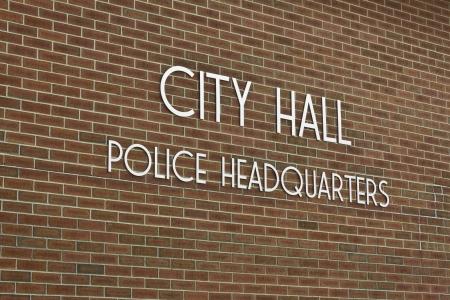 City Hall   Police Headquarters - Simple City Hall - Police Headquarters Sign Against Brick Background