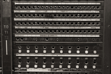 telephone: Closeup of a Vintage Bell System Telephone Switchboard with Plugs