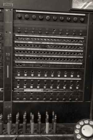 Closeup of a Vintage Bell System Telephone Switchboard with Plugs photo